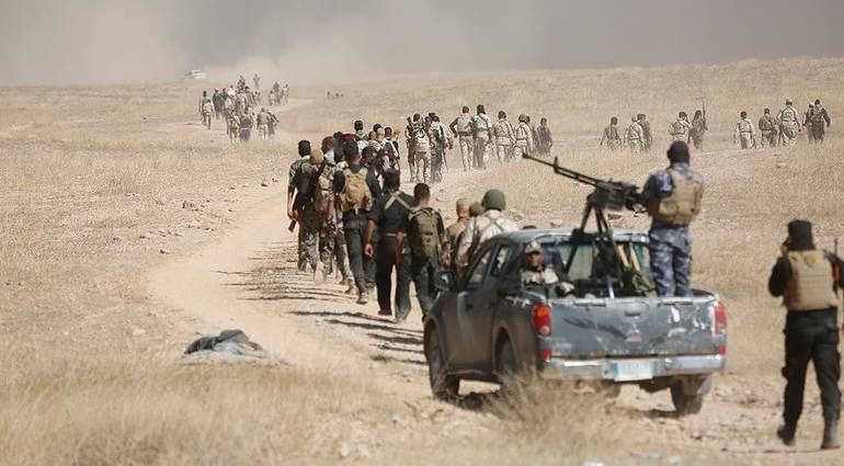 Military forces arrive at the outskirts of Tal Afar in preparation for their liberation