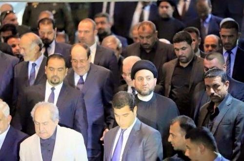 Image - Maliki laughs at the funeral of Chalabi