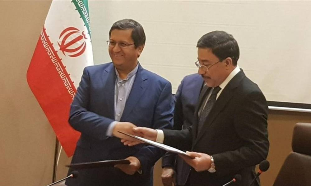 Baghdad repay the debt to Tehran .. an agreement between Ali Alaq and his counterpart
