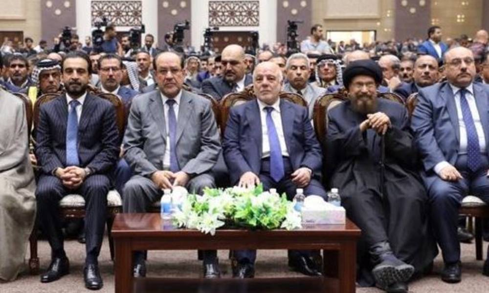 What is the secret of sitting Abadi and Maliki - together in the forefront